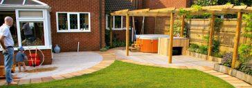 Wooden arbour and hot tub garden design