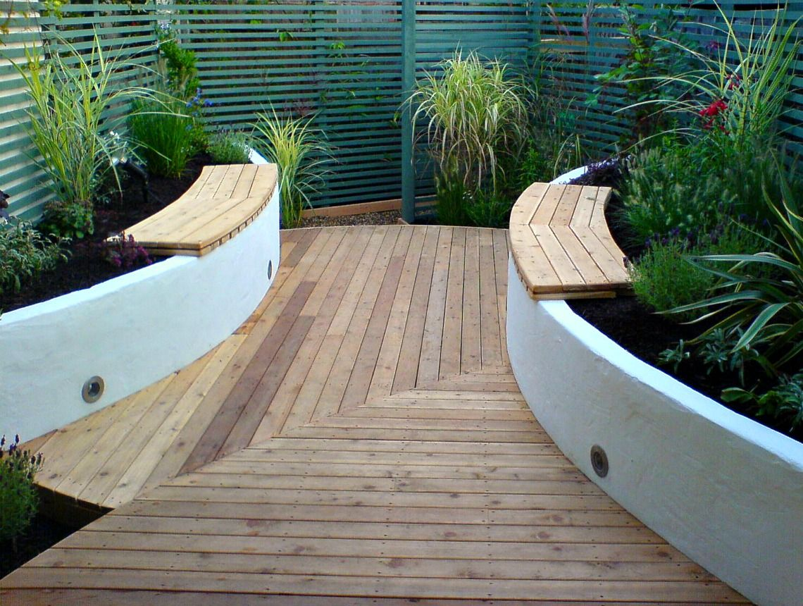 A small garden with a sailing theme and porthole lights